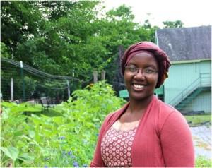 The author, Aude Isimbi, in her garden